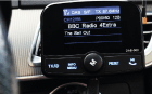 JustDAB product image - plug and play DAB car radio. JustDAB plugged into the vehicles cigar lighter socket